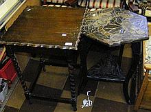 A carved Middle Eastern two tier occasional table,