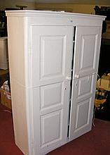 An antique painted pine two door wardrobe