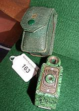 A Coronet Midget camera in mottled green Bakelite