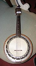 An old Italian? banjo with maker's name to the