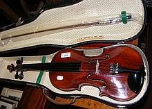 An antique violin with label to the interior,