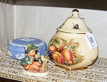A Hummel figure, together with a jar and cover and
