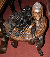 A carved Indian occasional table, together with