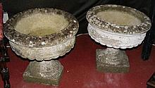 A pair of old stoneware garden urns