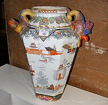Oriental vase with reliefwork stylised handles