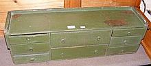 A green painted antique storage unit