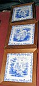 Seven decorative framed blue and white wall tiles