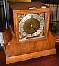 A walnut cased Art Deco style chiming mantel clock