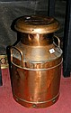 An old copper milk churn engraved