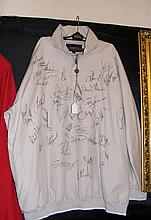 A Burberry golf jacket signed by numerous top