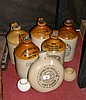 Five stoneware jars, ditto hot water bottle etc.