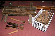 A quantity of early leather worker's tools including large clamp, etc