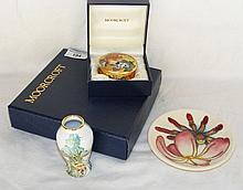 A 12cm diameter Moorcroft pin dish, Moorcroft enamel pill box with hinged l