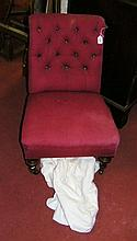 A Victorian nursing chair with shaped deep button back and overstuffed seat