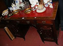 Mahogany kneehole desk with tooled inset leather top