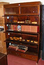 A seven section mahogany Globe Wernicke style bookcase with lockable compar
