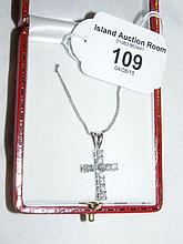 An eleven stone diamond cross and chain set in 18ct white gold
