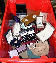 Quantity of costume jewellery in presentation boxes, including rings, brooc