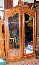 A French walnut double robe enclosed by bevelled mirrored doors