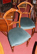 A set of six Victorian walnut dining chairs with over-stuffed padded seats