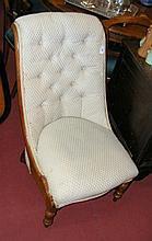 A Victorian mahogany framed nursing chair with deep button back and serpent