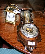 French brass carriage clock timepiece and an aneroid wall barometer/thermom