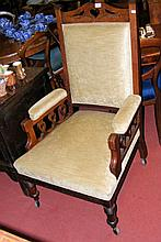 An Edwardian armchair on turned supports