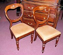 A set of four Victorian mahogany dining chairs with overstuffed padded seat