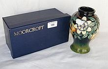 A 16cm Moorcroft vase with passion flower and fruit decoration - boxed