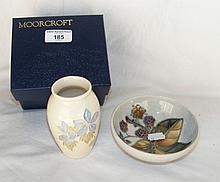 A 12cm diameter Moorcroft bowl with berry decoration, together with a simil
