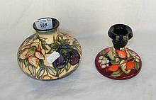 A 11cm Moorcroft vase, together with a Moorcroft candlestick