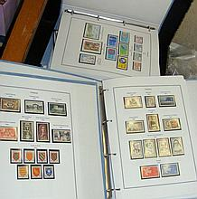 An extensive collection of French postage stamps contained in six pale blue