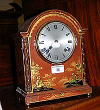 A chinoiserie decorated lacquered case striking mantel clock with silvered