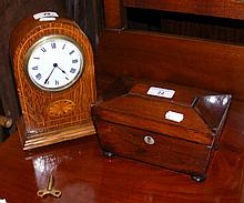 Rosewood casket shaped two compartment tea caddy and a mantel clock timepie