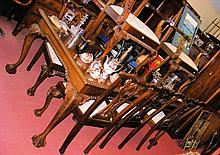 A 208cm x 108cm Chippendale style mahogany dining table on carved supports