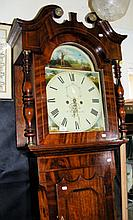 An 8-day oak and mahogany longcase clock, the arched dial and spandrels dec