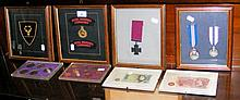 """Four framed and glazed medals and insignia, including """"The Queen's Gallantr"""