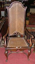 A mahogany framed open armchair with cane work seat and back rest