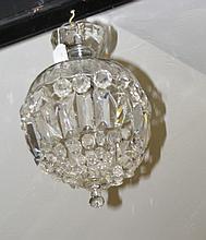 A decorative crystal drop hanging ceiling light pendant
