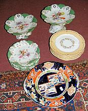 A floral decorated porcelain part dessert service, comprising comport, half