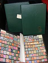 Three green stock books of mint stamps