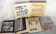 Selection of world stamps in four stock books