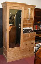 An Edwardian ash combination robe with drawers and cupboard flanked by mirr