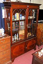 A 122cm inlaid mahogany display cabinet with cupboards under