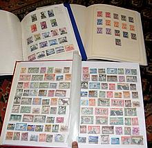 One album and one stock book of British Colony postage stamps and an album