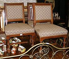 Set of four late Victorian oak Gothic style dining chairs
