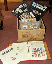 A large collection of assorted world postage stamps - loose and in albums