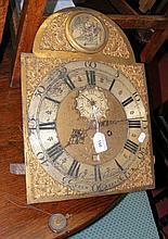 A brass longcase clock movement only with arched dial, separate seconds and