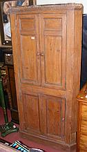 Antique pine corner cupboard, having enclosed shelves to top and cupboard b