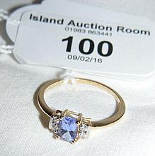Tanzanite and diamond ring in 9ct gold setting